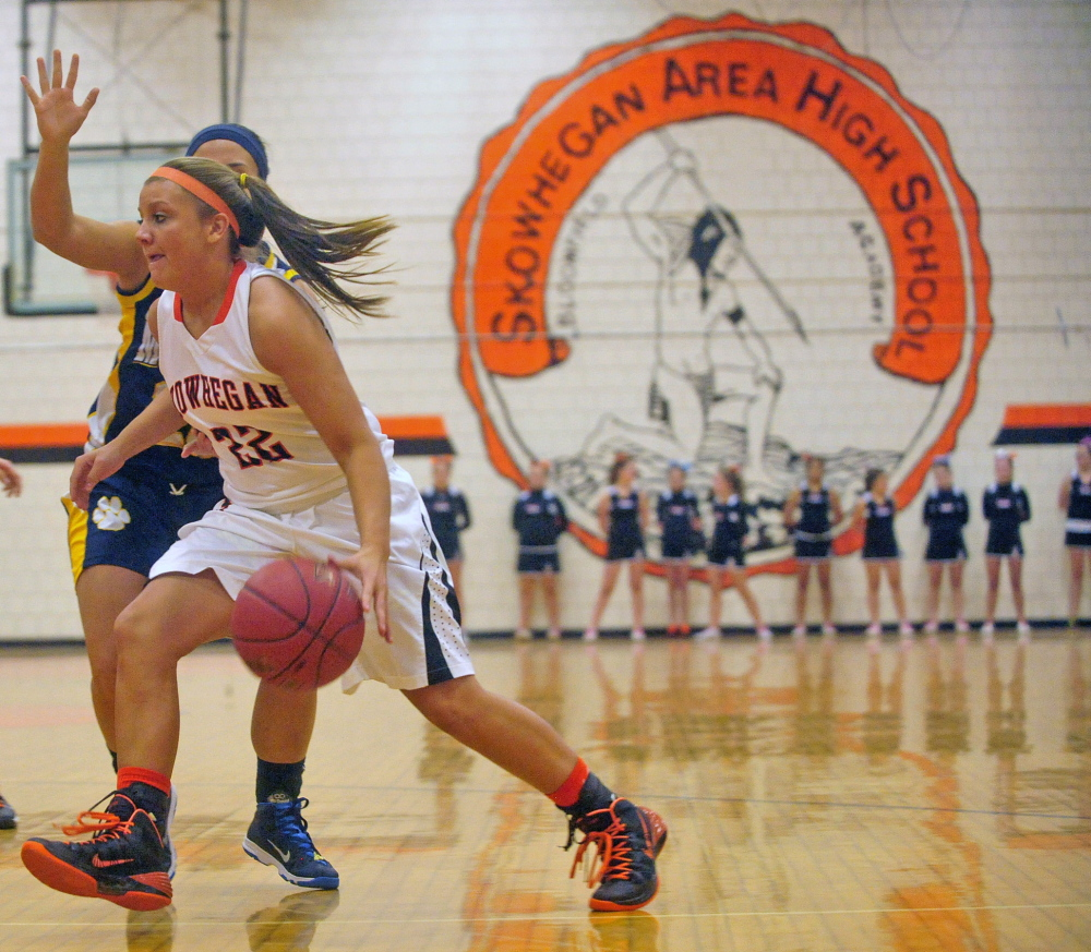 Mascot Change: The Skowhegan Area High School Indian mascot is emblazoned on the wall of the gymnasium during a game against Mt. Blue High School in Skowhegan in December 2013.