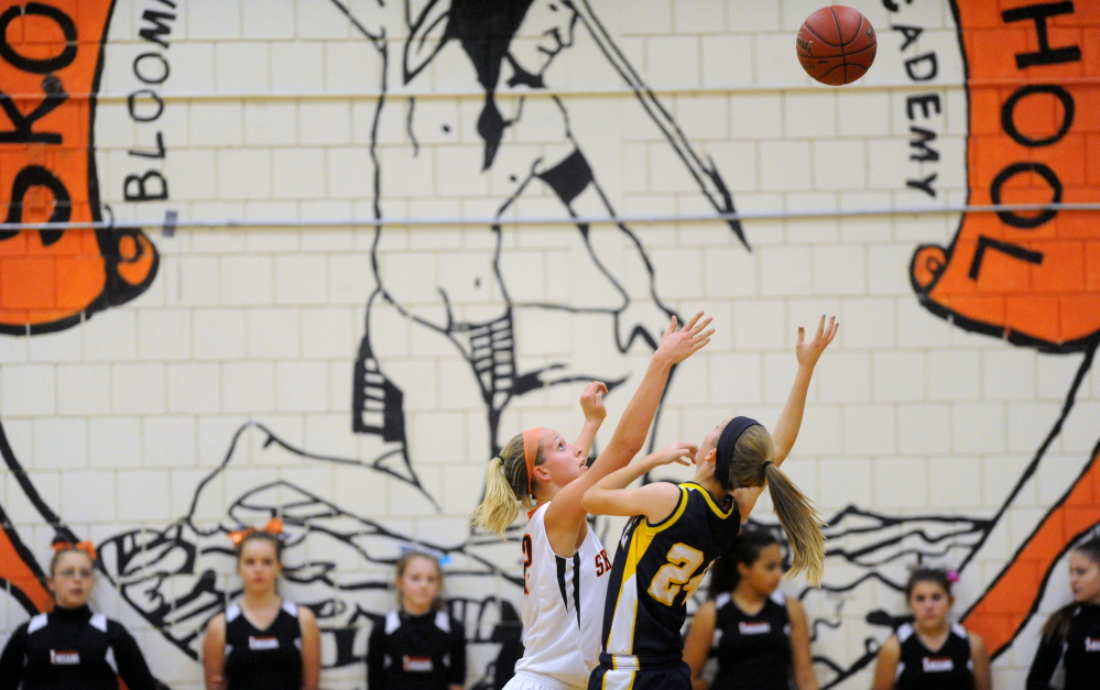 Offensive?: The Skowhegan Area High School Indian mascot is emblazoned on the wall of the gymnasium during a game against Mt. Blue High School in Skowhegan in December 2013.