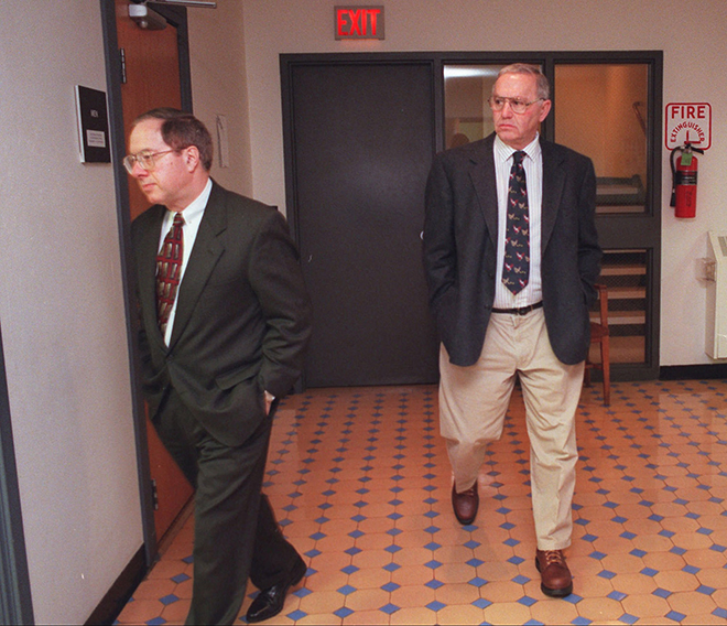 In this 1997 file photo Jack DeCoster, right, follows his attorney Bill Smith to the courtroom in the Wright County Court house to testify in defense of his family's hog confinement facilities in Clarion, Iowa.