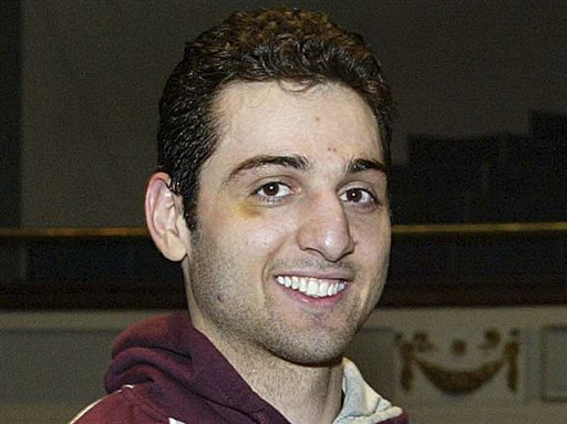 Tamerlan Tsarnaev smiles after accepting a trophy for winning the 2010 New England Golden Gloves Championship in Lowell, Mass., in this Feb. 17, 2010, photo.