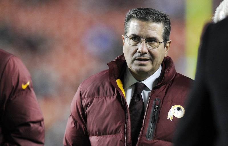 "In this December 2013 file photo, Washington Redskins owner Dan Snyder walks off the field before an NFL football game. Snyder said on April 22, 2014, it's time for people to address ""real issues"" concerning Native Americans instead of criticizing the team's nickname."
