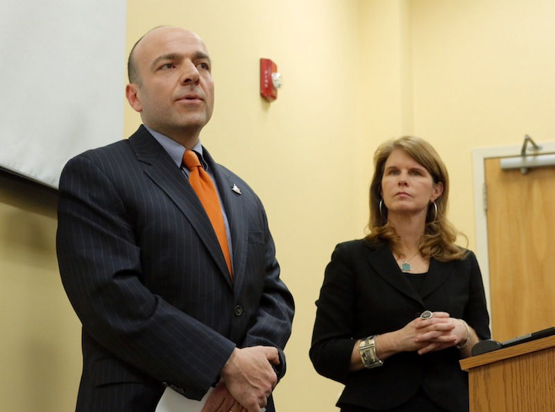 Gary Alexander, founder of the Alexander Group, answers questions in January in Augusta about his analysis. At right is Mary Mayhew, commissioner of the Maine Department of Health and Human Services.