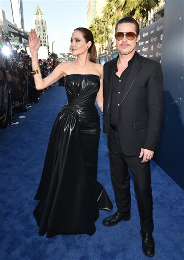 "Angelina Jolie and Brad Pitt arrive at the world premiere of ""Maleficent"" in Los Angeles on Wednesday."