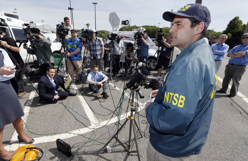 National Transportation Safety Board senior air safety investigator Luke Schiada speaks during a news conference at Hanscom Field in Bedford, Mass., on Sunday, after a fiery plane crash killed seven people.