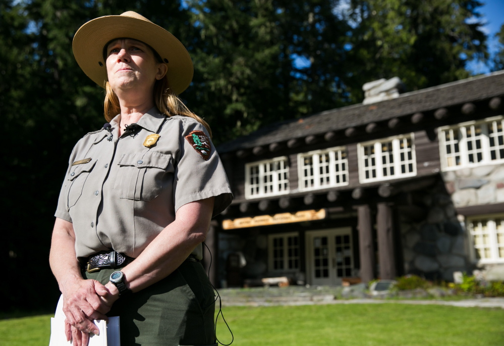 Mount Rainier National Park spokeswoman Patti Wold briefs reporters in Ashford, Wash., on Saturday about search and rescue efforts for six missing climbers on Mount Rainier.