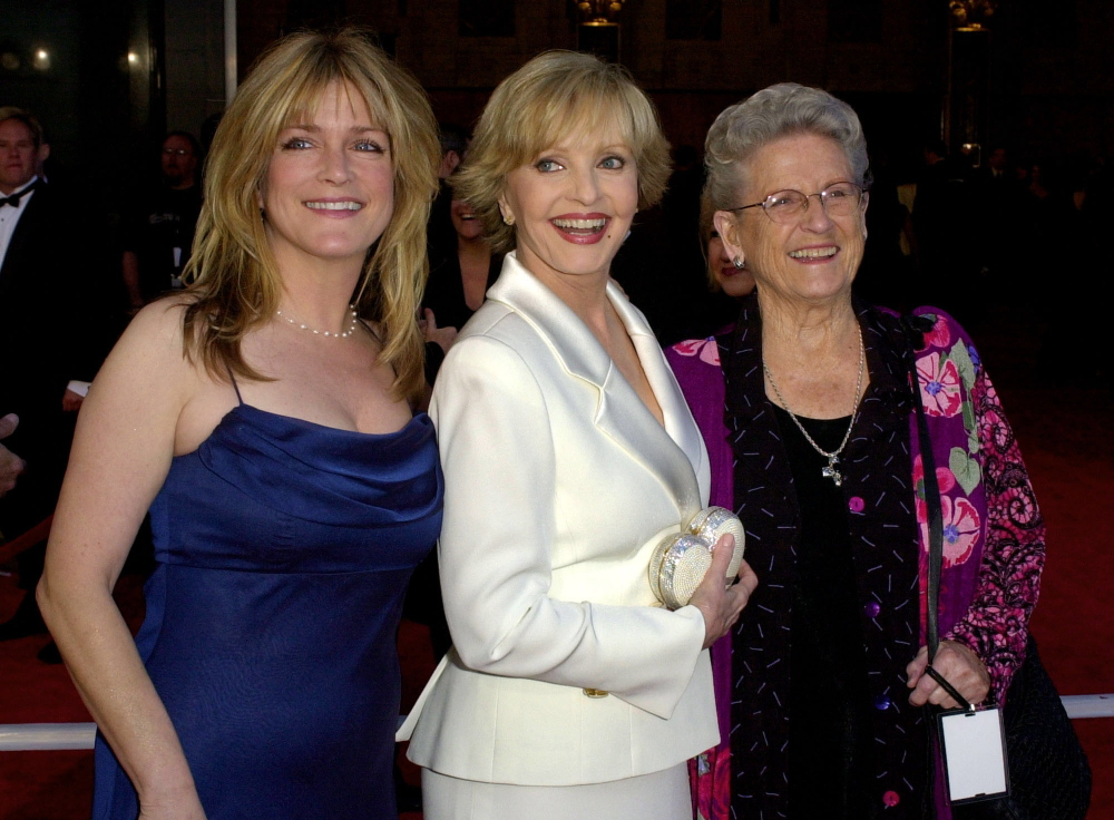 "Florence Henderson, center, is flanked by fellow cast members of ""The Brady Bunch"" television show Susan Olsen, left, and Ann B. Davis as they arrive to ABC's 50th Anniversary Celebration Sunday, March 16, 2003, at the Pantages theater in Los Angeles."