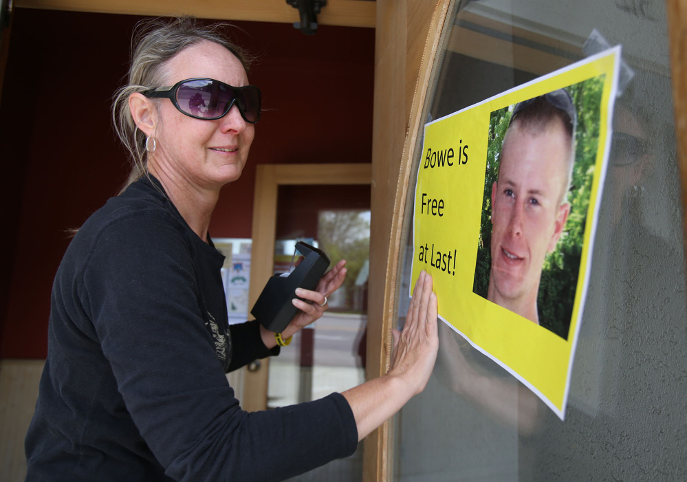 Sondra Van Ert, co-owner of Baldy Sports, hangs a sign celebrating news of Army Sgt. Bowe Bergdahl's release Saturday in Hailey, Idaho, his hometown. Bergdahl, 28, had been held prisoner by the Taliban since June 30, 2009.