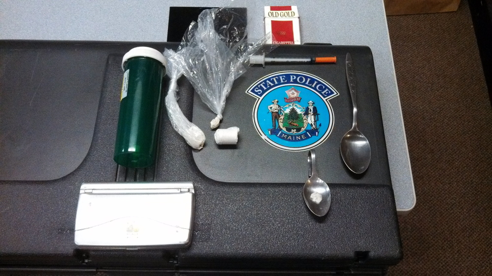 Evidence: Drug paraphernalia in plain view in a motor vehicle led to the discovery of heroin with an estimated street value of $5,000.