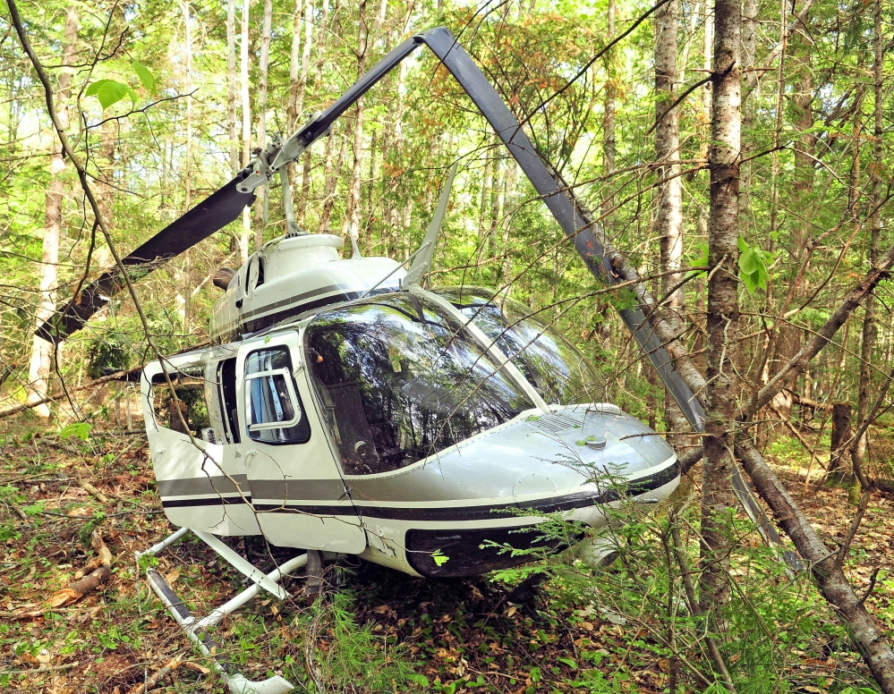 HELICOPTER CRASH: Investigators are still trying to determine what caused a helicopter to crash Friday in the woods in Whitefield.