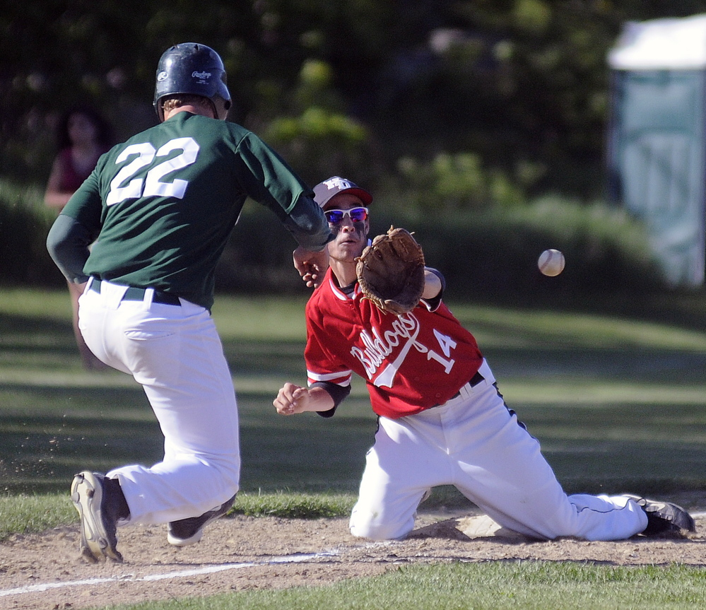 GOTCHA: Hall-Dale High School's Quinn Stebbins collects a throw to third to pick off Winthrop High School's Mario Meucci Tuesday in Farmingdale.