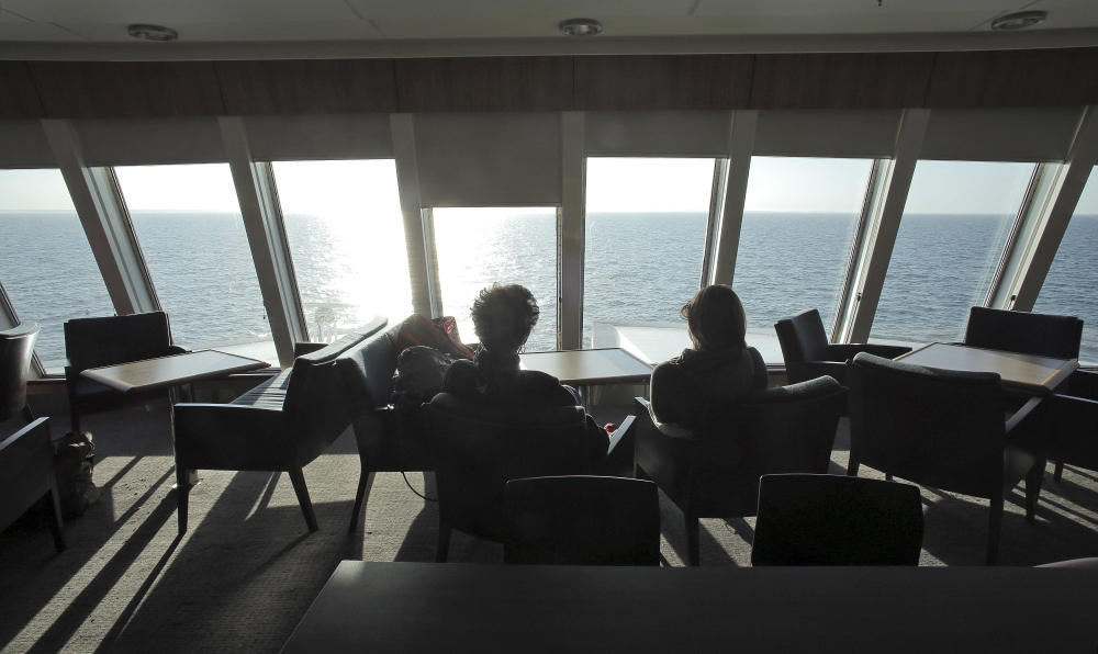 Passengers enjoy the view from above the bow inside the forward lounge shortly before the Nova Star ferry arrives at Yarmouth, Nova Scotia, on its maiden voyage from Portland on May 16. The ferry company expects 100,000 customers this season, which runs until Nov. 1.