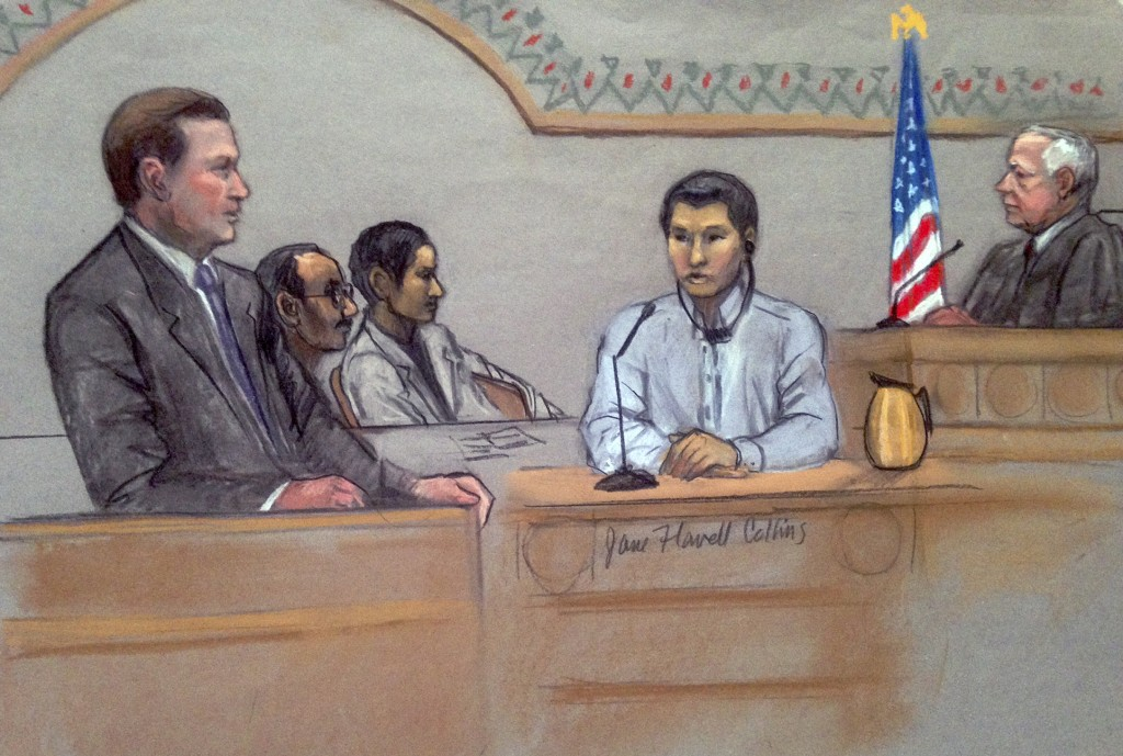 In this courtroom sketch, Dias Kadyrbayev, second from right, testifies in federal court Monday in Boston. Kadyrbayev, a native of Kazakhstan, is accused of removing items from Dzhokhar Tsarnaev's dorm room several days after the 2013 marathon bombings.