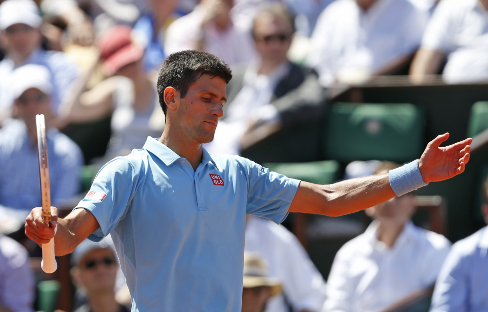 The Associated Press Serbia's Novak Djokovic gestures during the semifinal match of the French Open tennis tournament against Latvia's Ernests Gulbis at the Roland Garros stadium, in Paris, France, on Friday.