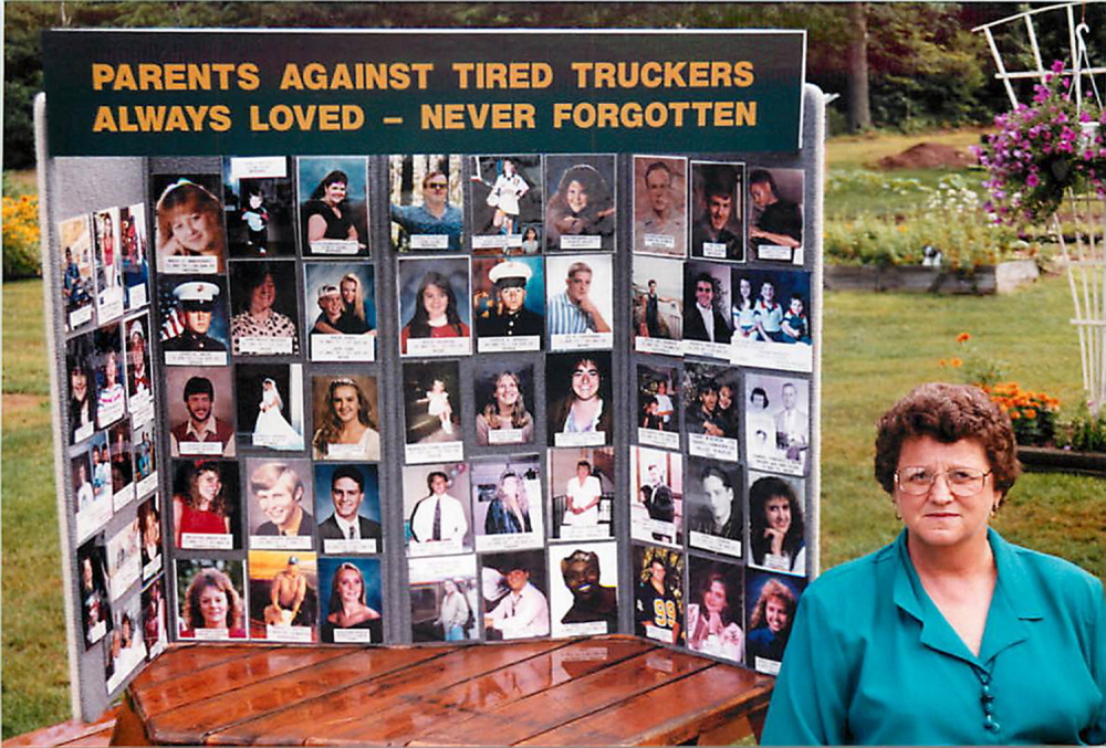 trucksafety.org TIRED TRUCKERS KILL: Daphne Izer of Lisbon poses beside a collage of photos of young adults who have been killed by tired truckers. Izer's son, Jeff, was killed Oct. 10, 1993, when the car in which he was riding was crushed by an 80,000-pound tractor-trailer, the driver of which had fallen asleep at the wheel. Later, Izer and her husband, Steve, formed Parents Against Tired Truckers to lobby for stricter sleep rules for truckers and to support the families who suffered similar losses.
