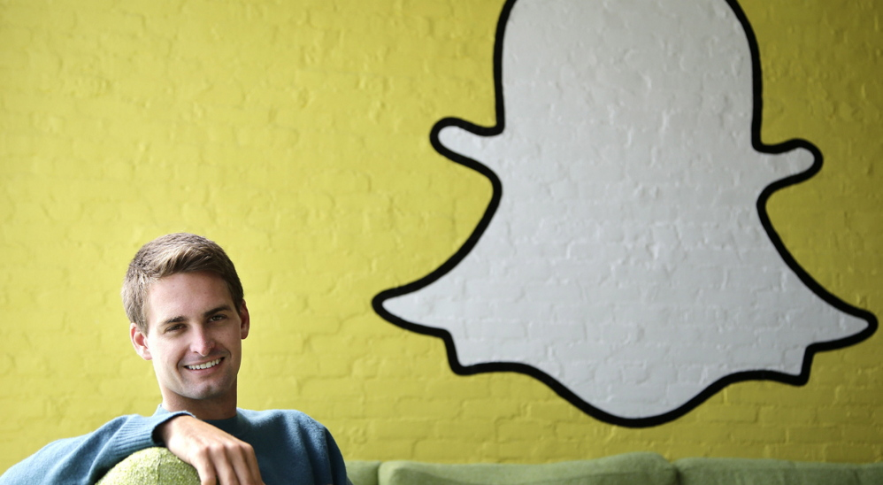AP file photo MISOGYNY OR FRAT BOY HUMOR?: In this Oct. 24 file photo, Snapchat CEO Evan Spiegel poses for photos in Los Angeles. Spiegel dropped out of Stanford University in 2012, three classes shy of graduation, to move back to his father's house and work on Snapchat. Spiegel's fast-growing mobile app lets users send photos, videos and messages that disappear a few seconds after they are received.