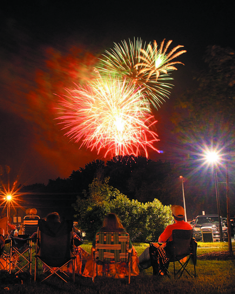 Original: Photo by Jeff Pouland LIGHTING UP THE SKY: Fireworks light up the sky over the Hathaway Creative Center in Waterville on Wednesday night. The fireworks show was part of the Winslow Family 4th of July Celebration.