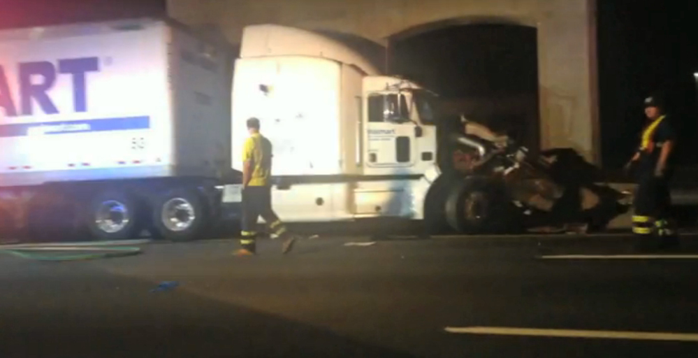"""The Associated Press In this image from video the Wal-Mart truck involved in the crash of the limousine bus carrying Tracy Morgan and six other people is seen early Saturday morning June 7, 2014 on the New Jersey Turnpike at the accident scene. Morgan remained hospitalized as state and federal officials continued their investigation of the six-vehicle crash on the New Jersey Turnpike that took the life of a Morgan friend and left two others seriously injured, authorities say. Wal-Mart President Bill Simon said in a statement a Wal-Mart truck was involved and that the company """"will take full responsibility"""" if authorities determine that its truck caused the accident."""