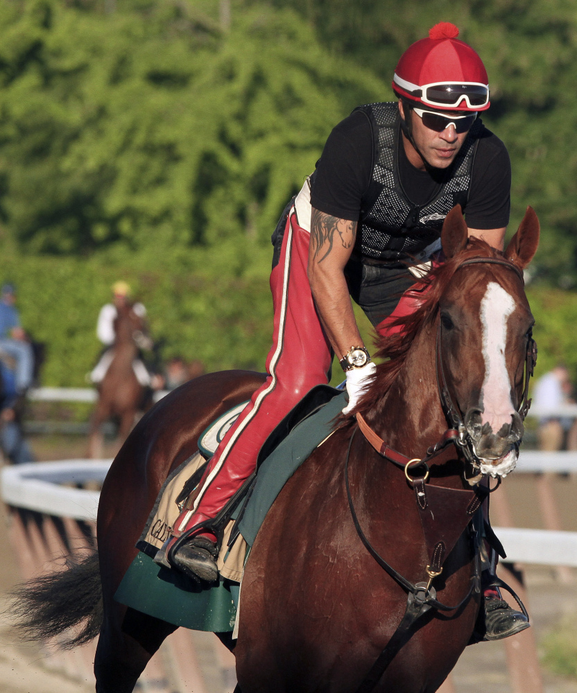 The Associated Press/Garry Jones Exercise rider Willie Delgado gallops California Chrome around the track during a workout at Belmont Park, Friday, June 6, 2014, in Elmont, N.Y. The Kentucky Derby and Preakness Stakes winner will attempt to become the first Triple Crown winner since Affirmed in 1978 when he races in the146th running of the Belmont Stakes horse race on Saturday.