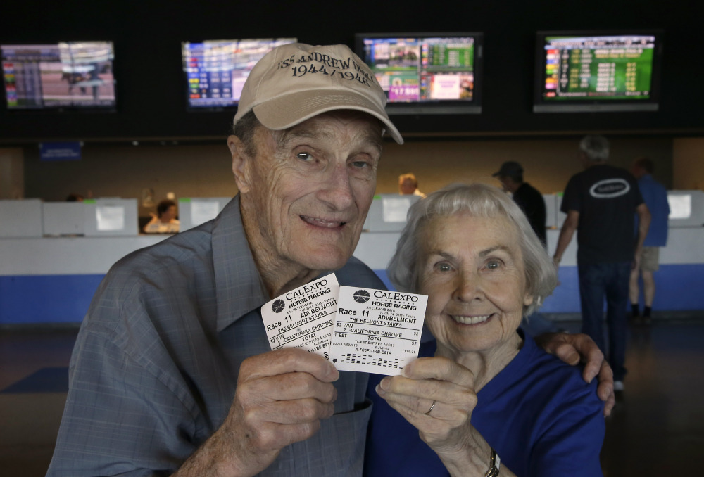 The Associated Press/Rich Pedroncelli Harold Walter and his wife, Catherine, display their $2 advance wagers they placed on California Chrome, at the CalExpo racetrack in Sacramento, Calif. on June 6, 2014. California Chrome, the Kentucky Derby and Preakness Stakes winner, will attempt to become the first Triple Crown winner since Affirmed in 1978 when he races in the 146th running of the Belmont Stakes horse race on Saturday.