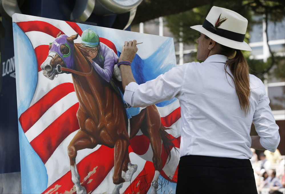 The Associated Press/Kathy Willens Artist Susan Sommer-Luarca, of Springfield, Mo., paints an image of Triple Crown hopeful California Chrome outside the grandstand at Belmont Park during the undercard races for the Belmont Stakes horse race, Saturday, June 7, 2014, in Elmont, N.Y.