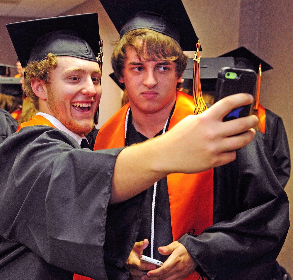 Staff photo by Joe Phelan Picture this: Josh Mashke, left, takes a selfie Saturday evening with John Pearson before Gardiner Area High School's graduation at the Augusta Civic Center.