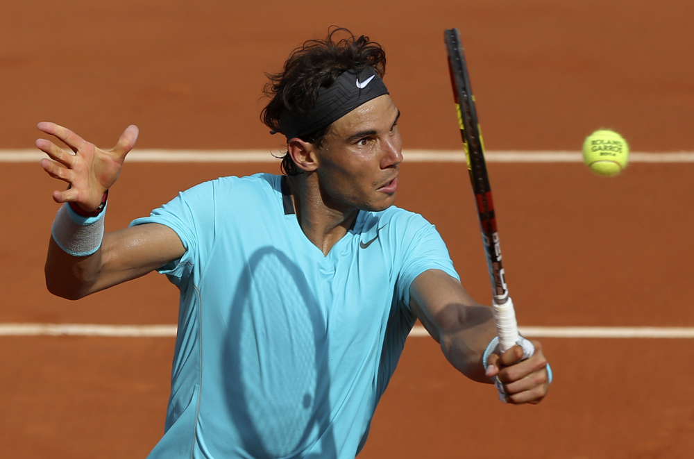 The Associated Press Rafael Nadal volleys the ball to Novak Djokovic during their final match of  the French Open Sunday. Nadal won his ninth French Open title with a 3-6, 7-5, 6-2, 6-4 win.