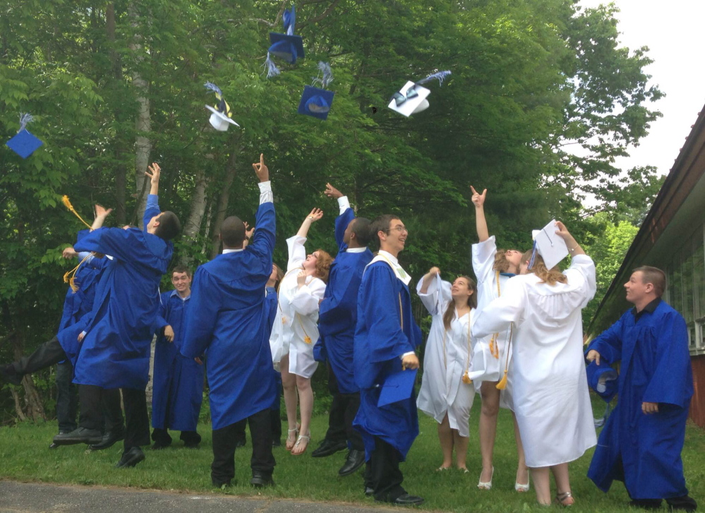 Staff photo by Jesse Scardina One last fling: Graduates of Upper Kennebec Valley Memorial High School toss their caps into the air Sunday after their commencement ceremony at the school in Bingham.