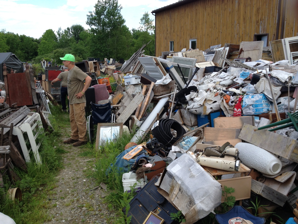 Staff Photo by Matt Hongoltz-Hetling STAND-OFF: Ralph McLaughlin, manager of the Fairfield Antique Mall on U.S. Route 201 in Fairfield, stands along a right of way the business has through the neighboring property of Maine 201 Antiques next door.