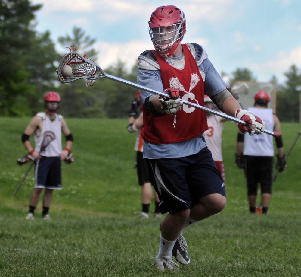 Staff photo by Andy Molloy GAINING EXPERIENCE: Cony's Nic Benner tosses a pass during practice Monday.