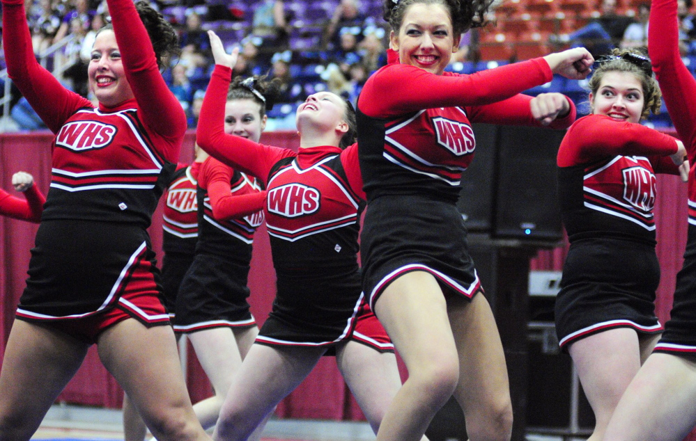 Joe Phelan / Kennebec Journal Staff Photographer The Wells team performs during the state cheerleading championships at the Augusta Civic Center in this 2012 file photo.