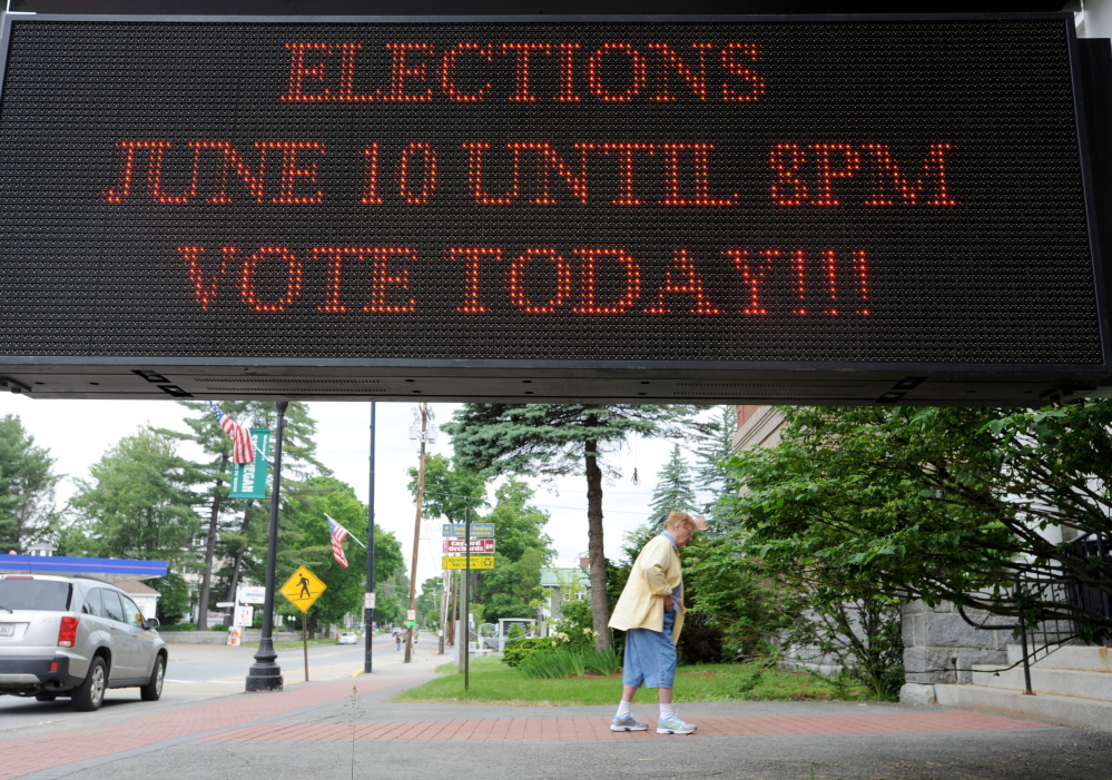 Staff photo by Michael G. Seamans Voting: A voter walks in to the Skowhegan Town Office to vote in the state primary and local election Tuesday.