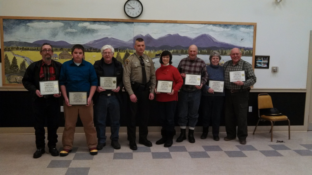 Citizen Police Academy graduates: From left are Michael Steward, Merrill Steward, John Tompkins, Corporal Christopher Chase, Sally Iverson, Neil Iverson, Jo Craemer and Ray Craemer.