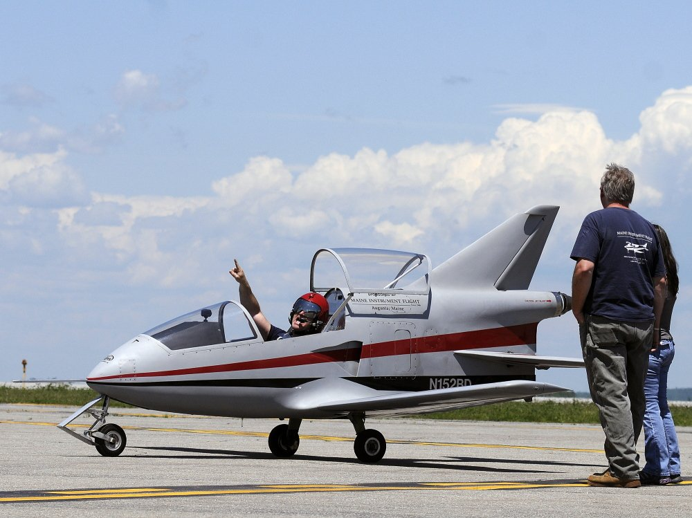 UP UP AND AWAY: Pilot Peter Reny of Augusta taxis Monday on the tarmac of the Augusta State Airport before taking off in his Bede-BD5 microjet.