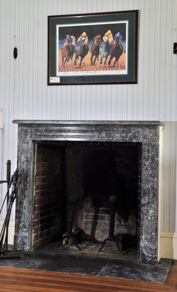 For Sale: An upstairs bedroom features a fireplace at Maine Chance Spa, the estate formerly owned by Elizabeth Arden that is for sale now.