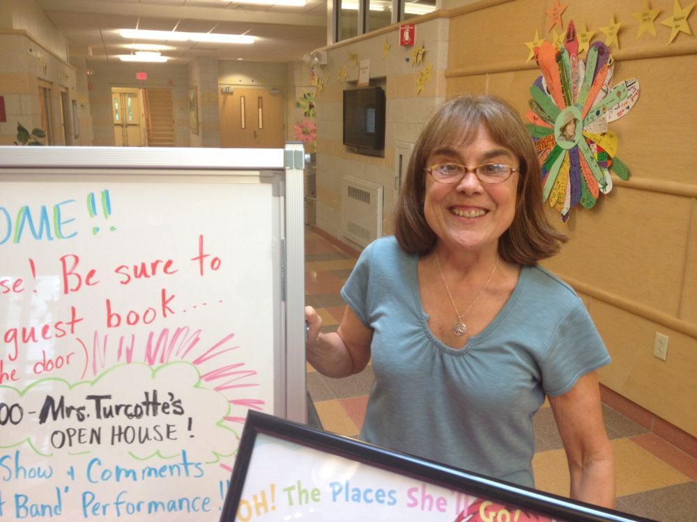 LIBRARIAN HONORED: Students, parents and teachers gathered at the Mallett School in Farmington Thursday to honor Betsy Turcotte, who is retiring as the school librarian after two decades encouraging thousands of students in kindergarten through third grade to develop an interest in books