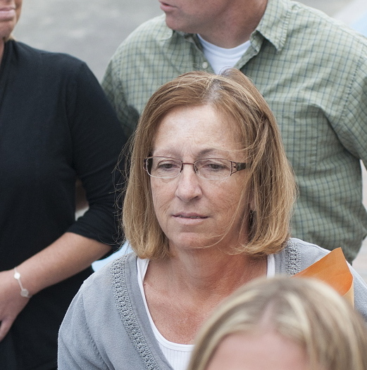 Sentenced: Carole J. Swan, former Chelsea selectwoman, with her son John Swan, as they enter the U.S. District Court building in Bangor Friday for her sentencing hearing on extortion, tax fraud and workers compensation fraud.