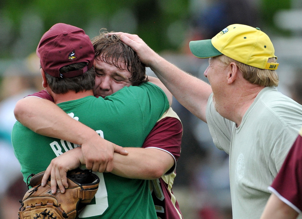 Victory: Caribou High School pitcher, Sean Sadler, 15, facing, celebrates family after defeating Winslow High School 3-2 in extra innings in Winslow on Saturday.