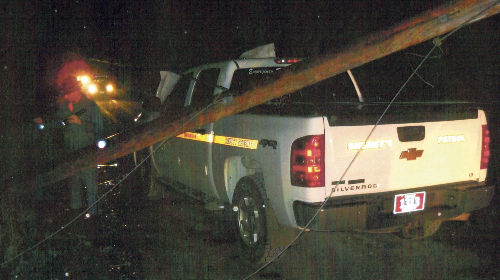 HAZARDOUS DUTY: A Somerset County Sheriff's Department truck was damaged after a utility pole fell on to it after John Howland of Norridgewock allegedly struck the pole last Sunday evening.