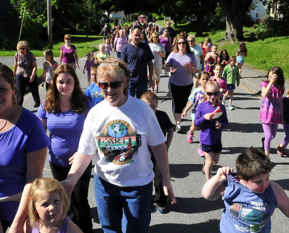 SUPPORT: More than 250 Atwood Primary School students, parents and staff marched through downtown Oakland to show support for students and siblings Adrianna and Blake Pettengill who are being treated for cystic fibrosis on Monday, June 16, 2014.