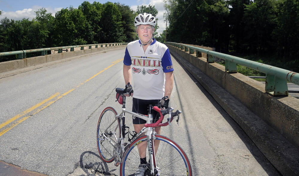 DETOUR: Patrick Gabrion of Hallowell rode on the overpass Sunday that spans the Maine Turnpike in Hallowell during his daily bike ride.
