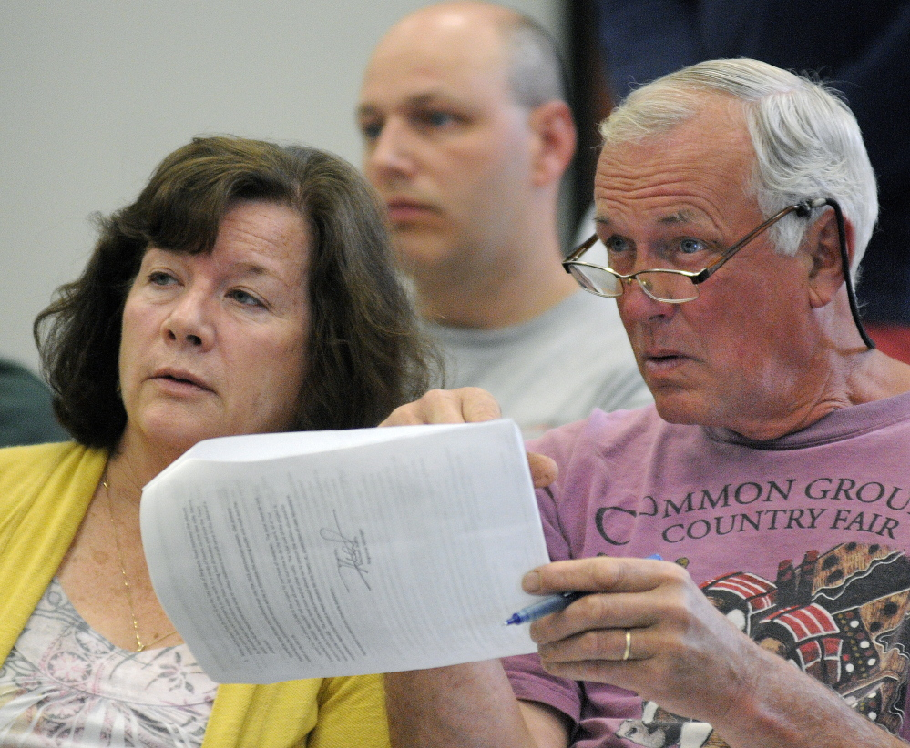 MOUNT VERNON: Geoffrey Herman and Susan Herman review an item on the Mount Vernon warrant Saturday, June 14, 2014, during the town meeting.