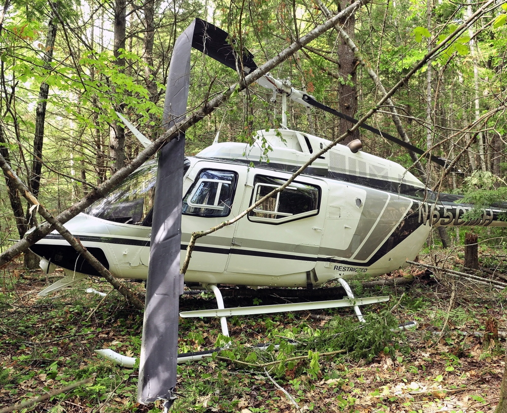 CRASH LANDING: A helicopter sits in the woods after a crash landing on May 30 in Whitefield.