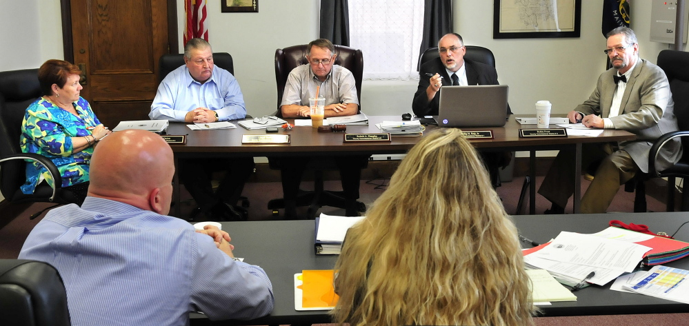 Staff photo by David Leaming   HEAR YE: The Somerset County Board of Commissioners held a budget workshop and meeting in Skowhegan on Wednesday, June 18, 2014. From left commissioners Lynda Quinn, Lloyd Trafton, Robert  Dunphy, Phillip Roy Jr. and Robin Frost deal with jail administration budget suggestions.