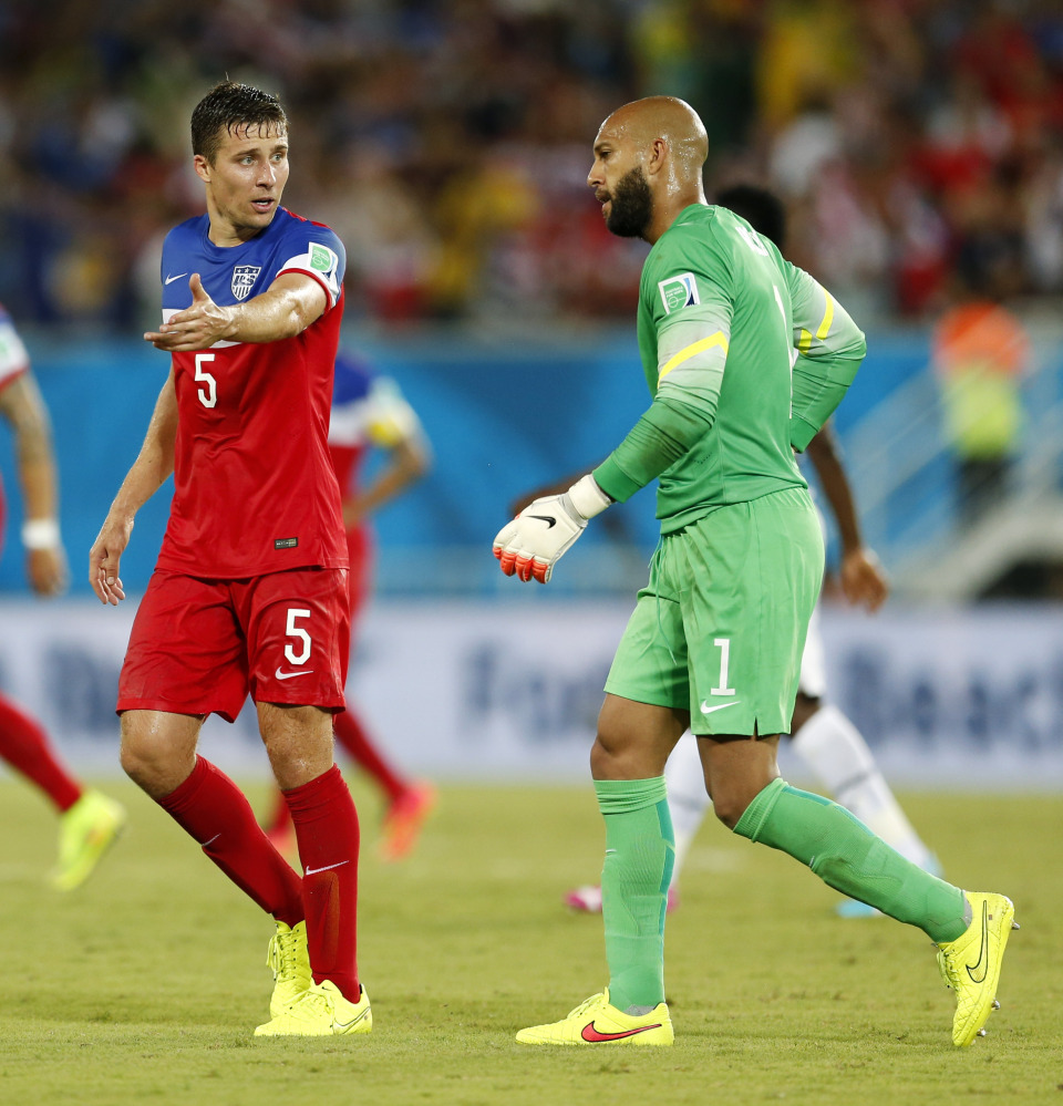Getting it done: United States' Matt Besler, left, talks to United States goalkeeper Tim Howard as they walk off the pitch at the half during the Group G World Cup soccer match Monday between Ghana and the United States at the Arena das Dunas in Natal, Brazil. The United States won 2-1.