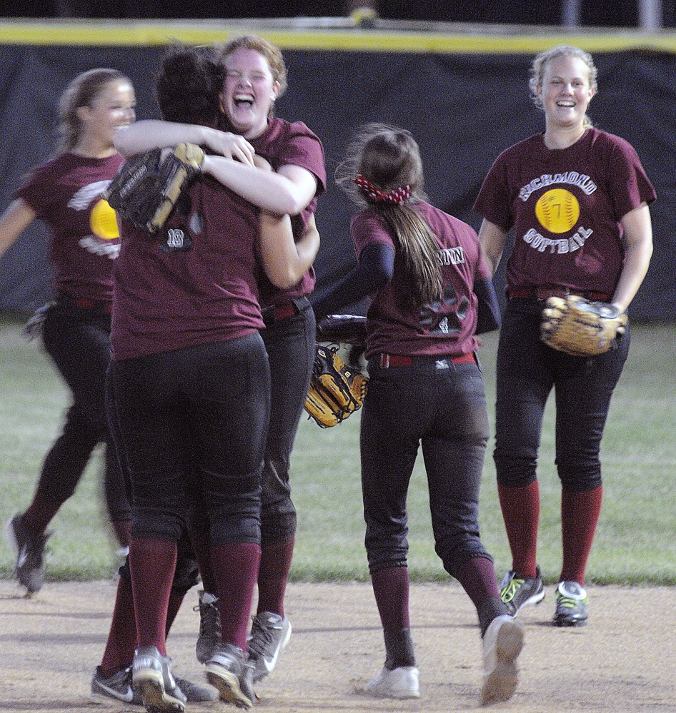 Richmond High School softball players celebrate their victory over Greenville High School at the end of the Western D softball final on Wednesday June 18, 2014 in Standish.