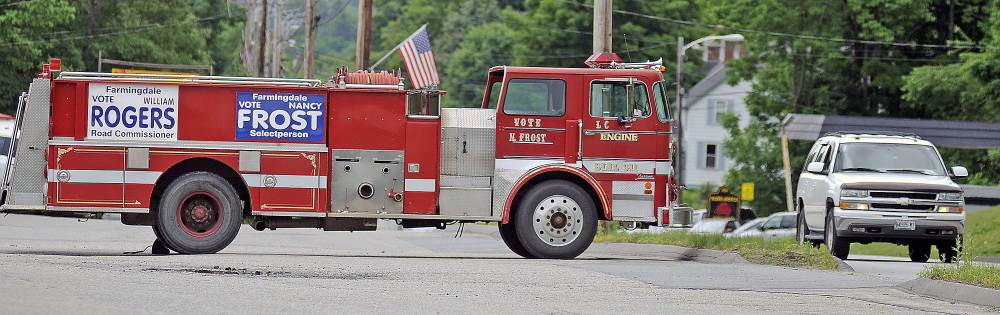 Town Election: A firetruck on U.S. Route 201 in Farmingdale is adorned with campaign signs for candidates for office in Farmingdale.