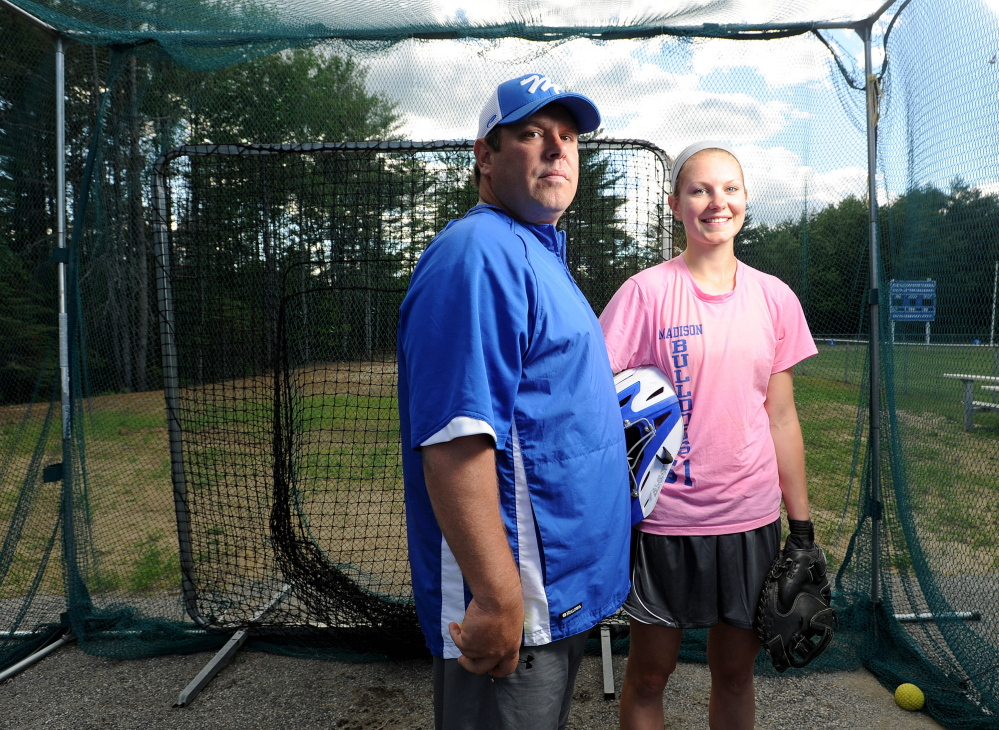 NO PROBLEM: Aly LeBlanc, right, has no problems with her dad Chris, left, coaching the Madison High School softball team. In fact, Aly is hitting .420 this season, with 28 RBIs.