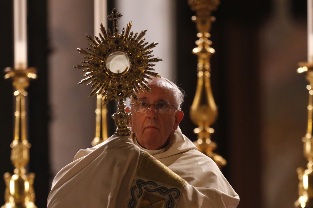 Pope Francis holds a monstrance containing a Holy Host at the end of the Corpus Domini procession from St. John at the Lateran Basilica to St. Mary Major Basilica to mark the feast of the Body and Blood of Christ, in Rome on Thursday.