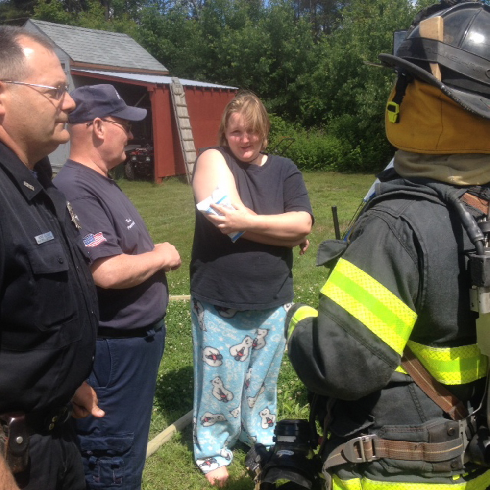 FIRE: Krista Corson, 19, holds a cold pack to minor burns she received when a grease fire ignited Friday morning at her home in Harvey's Mobile Home Park in Skowhegan. Corson and three other teenagers reportedly escaped the fire with no other injuries.