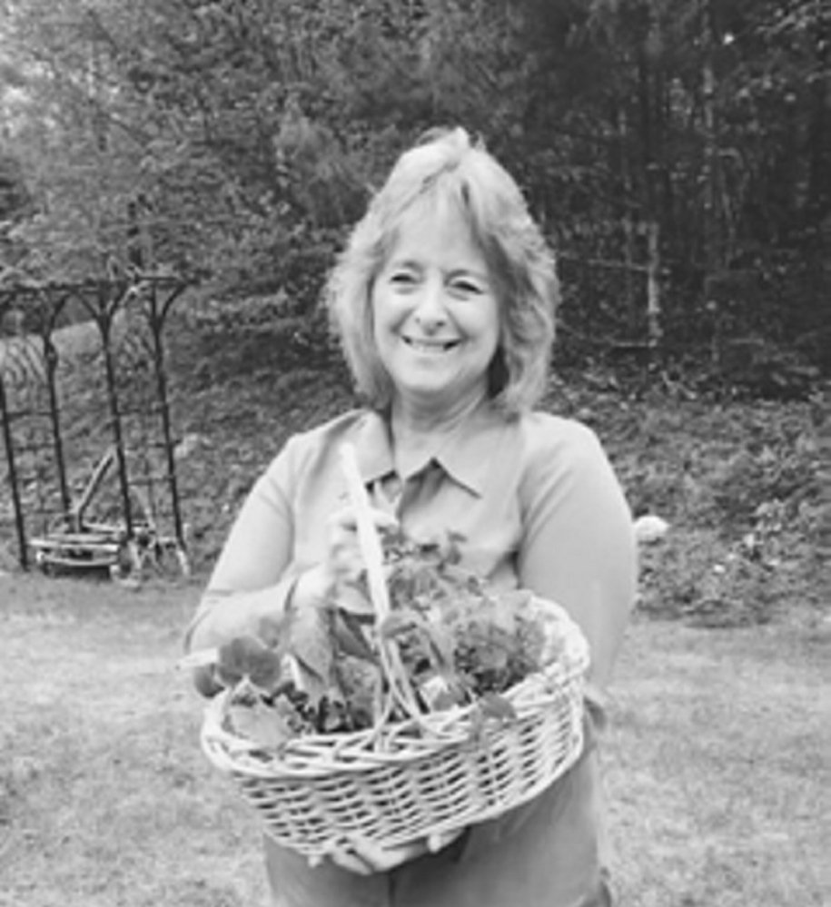 Linda Adkins holds the basket she won from the Monmouth Garden Club's raffle.